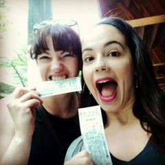Courtney and I demonstrate how excited we are to get tickets.  I bit mine to make sure it was real. (photo taken by Courtney)