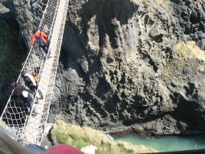 People crossing the bridge.