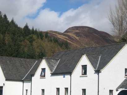 The mountains opposite the Loch, near the information centre.
